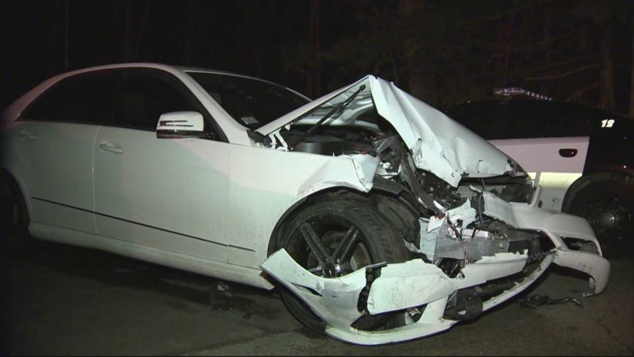 Police say a New Hampshire man crashed into three police cruisers, causing minor injuries to two Salem officers.