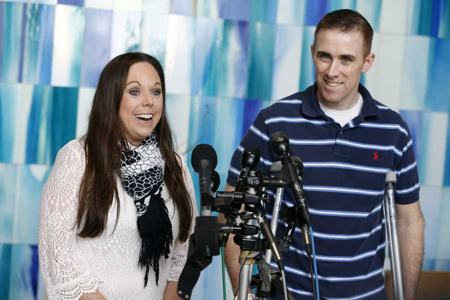 Transit police officer Richard Donohue, right, and his wife Kim speak with reporters before leaving Spaulding Rehabilitation Hospital in Boston, June 14, 2013. Dononhue was injured during a shoot-out with the Boston Marathon bombing suspects.
