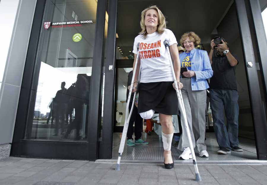 Boston Marathon bombing survivor Roseann Sdoia, of the North End neighborhood of Boston, leaves Spaulding Rehabilitation Hospital in Boston, May 14, 2013. Sdoia lost part of her right leg in the explosions near the finish line.