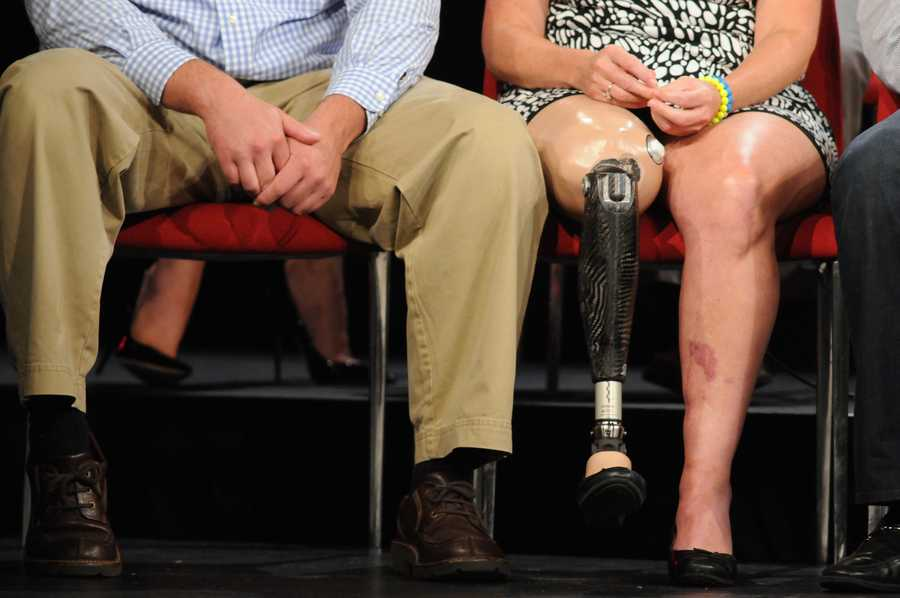 """Roseann Sdoia (right) sits next to Mike Materia, a Boston firefighter six months after the bombing at a taping for """"Boston Strong: Reunited,"""" which aired on WCVB-TV. Materia rode in the back of a Boston Police prisoner van with Sdoia to Mass. General Hospital."""