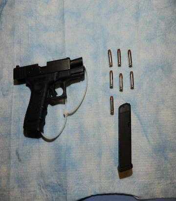 The FBI agent's gun.