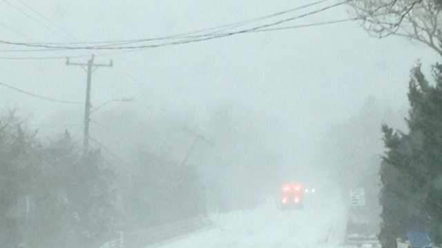 Snow falls in Dennis.