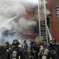Deputy Fire Chief Joseph Finn identified the two as Lt. Edward J. Walsh and firefighter Michael R. Kennedy.