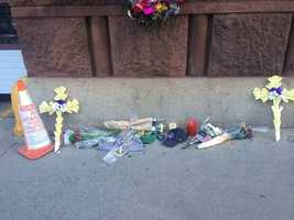 """Crosses and notes of being """"Boston Strong"""" were left."""