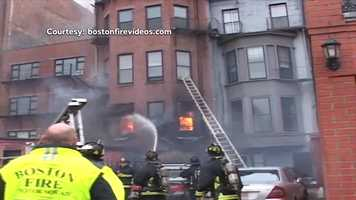 Deputy Fire Chief Joseph Finn said the 9-alarm fire sent smoke and flames pouring from the roof and windows of the brownstone.