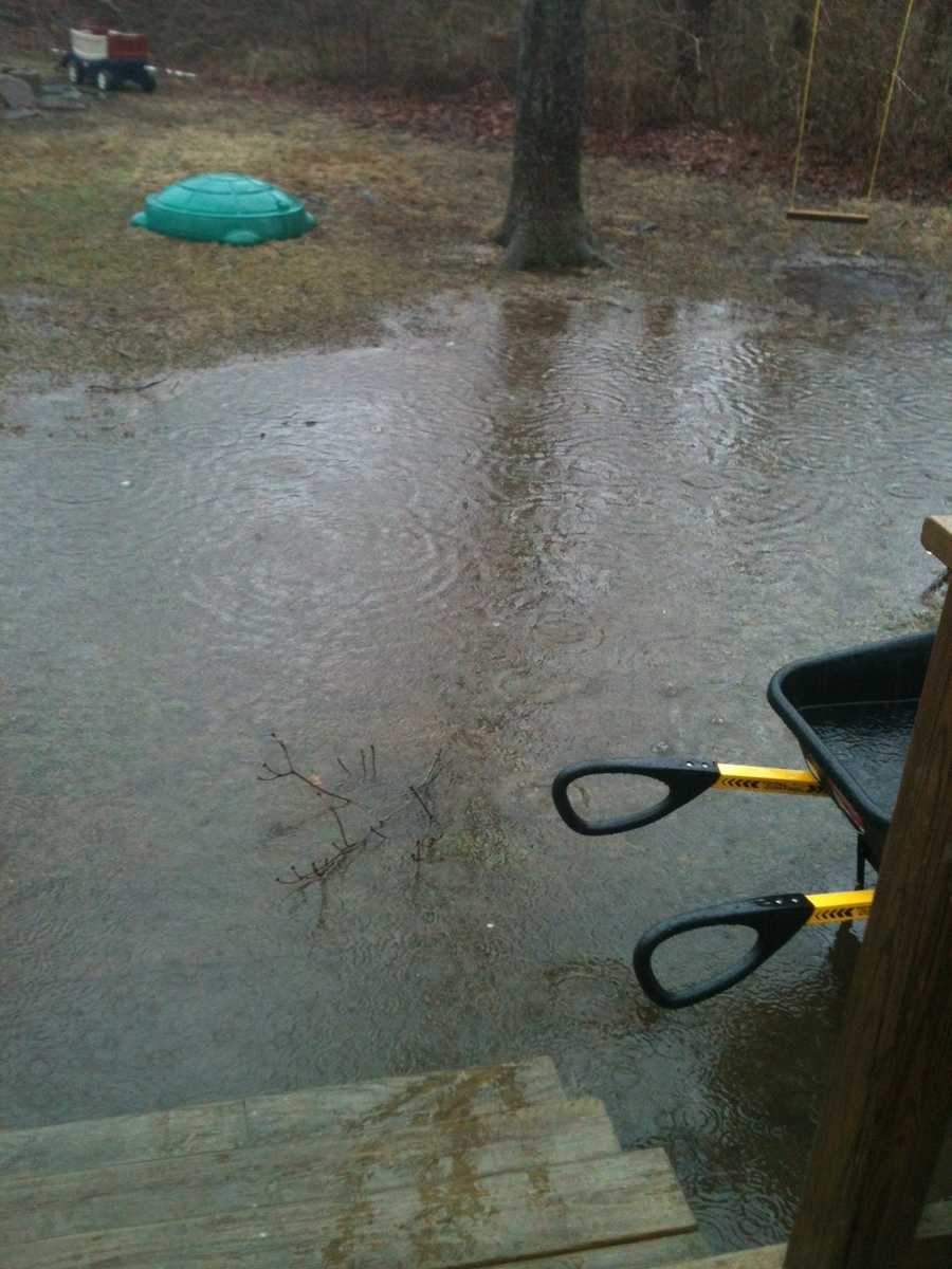 A flooded backyard in Plymouth.