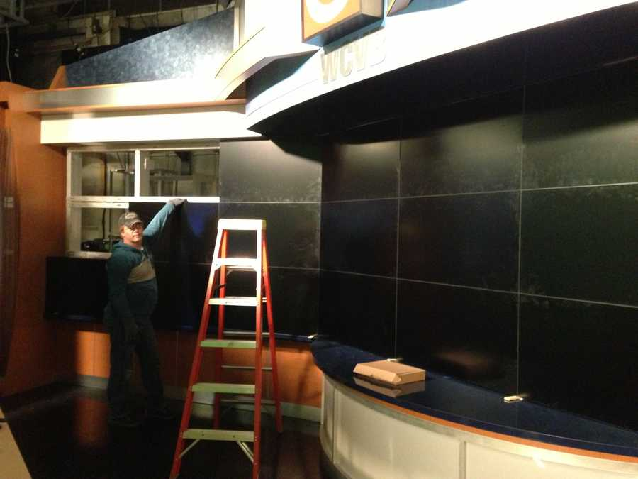 Most of the new video screens that make up the new monitor wall behind the anchors are installed.
