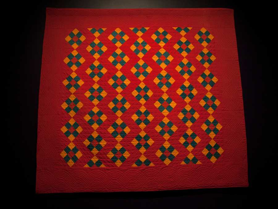 """Vibrations,"" presents quilts with complementary colors -- like red and green -- which cause the eye to see a ""vibration"" where the colors meet. To soften the effect on the eyes, some quilters added a third color to their designs."