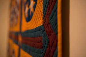 Anonymous women from diverse communities stretching from 19th-century Massachusetts and Amish and Mennonite Pennsylvania to Depression-era Missouri made the quilts.