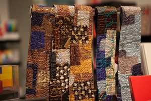 """Ties that are made of """"quilt"""" in the gift shop."""