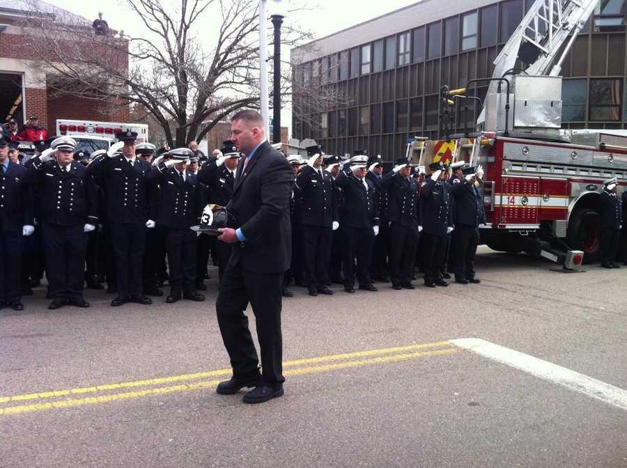 Lt Walsh's helmet being walked to his funeral