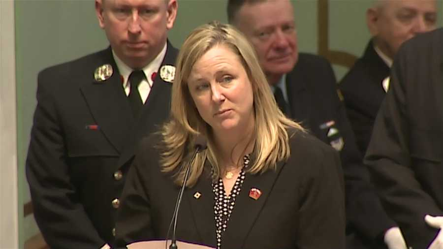 Kathy Malone, the sister of Lt. Ed Walsh, speaks at his funeral.
