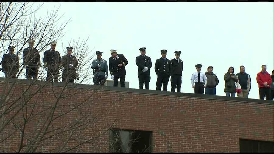 First responders watch from the roof of the building next to St. Patrick's Church in Watertown.