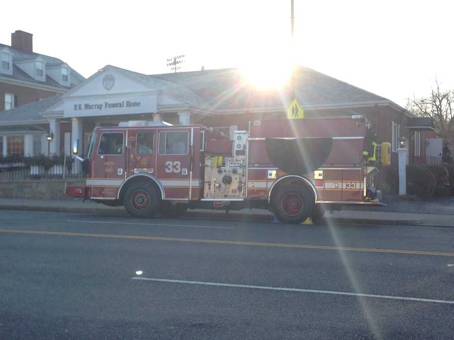 Kennedy's Engine 33 arrives at the funeral home to take Kennedy's body to the church.