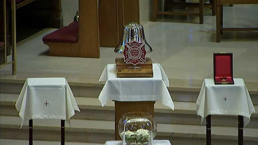 The bell that will be rung at the conclusion of the funeral service inside Holy Name Church.