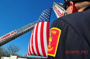 Boston firefighters raise the flag.