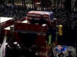 The body of Michael Kennedy arrives at Holy Name Church in West Roxbury.