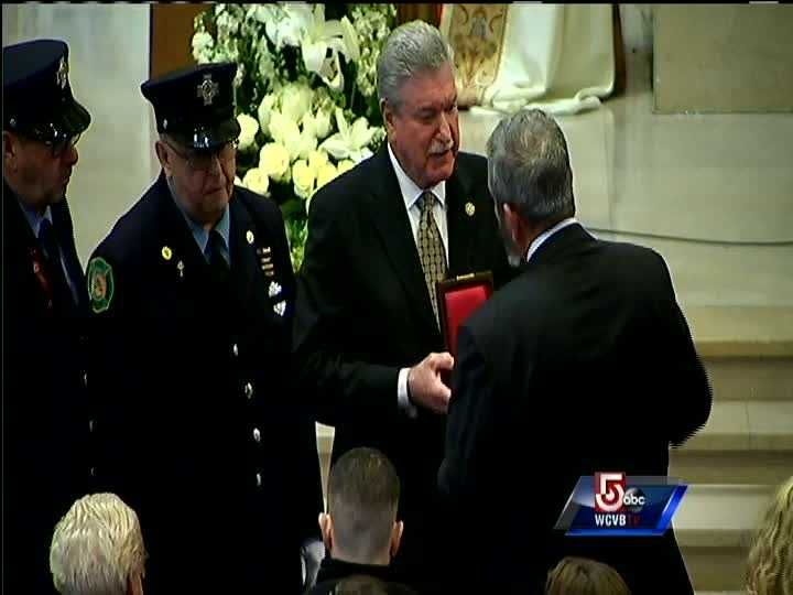 IAFF General President Harold Schaitberger, IAFF 3rd District Vice President Michael Mullane, and Boston Fire Fighters Local 718 President Rich Paris present the IAFF Medal of Honor.