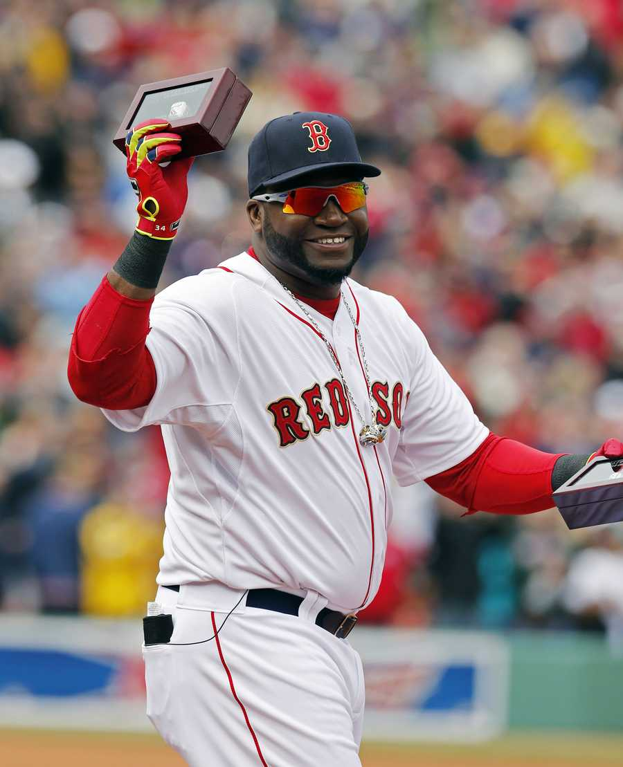 David Ortiz holds up his World Series ring during pre-game ceremonies.