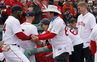 Boston Red Sox's David Ortiz greets Carlos Arredondo, center, and other survivors of the Boston Marathon bombing.