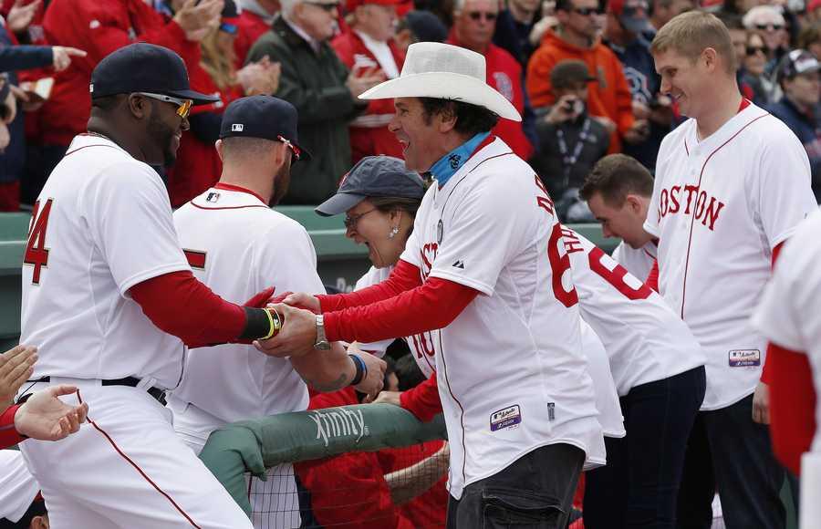 Boston Red Sox's David Ortiz greets Carlos Arredondo, center, and other survivors of the Boston Marathon bombing.