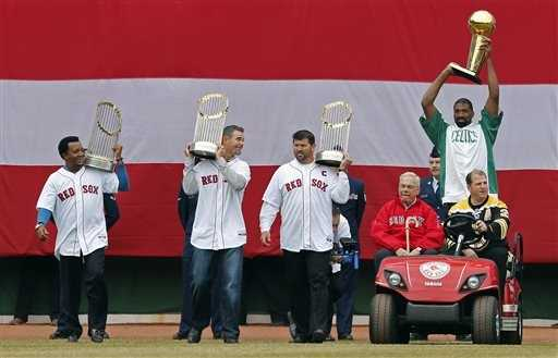 Former Boston Mayor Tom Menino drives in from left field with former Boston Bruins' Mark Recchi, former Boston Celtics' Leon Powe, and former Red Sox players Pedro Martinez, Mike Lowell and Jason Varitek.
