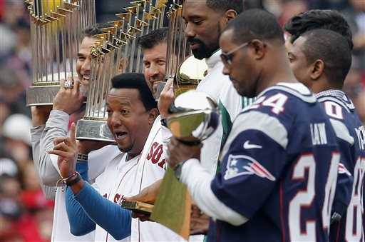 Pedro Martinez reacts while standing with Mike Lowell, Jason Varitek former Boston Celtics' Leon Powe and former players from the New England Patriots.