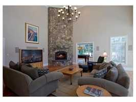 Great Room flooded with natural light, and elegant stone fireplace