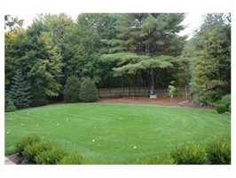 Gorgeous level lot with a forest of mature trees surrounding very private, well-landscaped grounds.