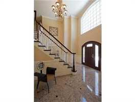 It hasfresh sunlit interiors and floor to ceiling windows