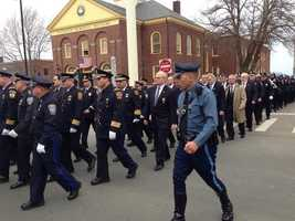 Trooper Dave Rizos gives the commands to some of the officers marching in to Maloney's wake.