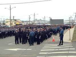 A sea of blue waiting to walk by to pay respects to Plymouth Officer Maloney.