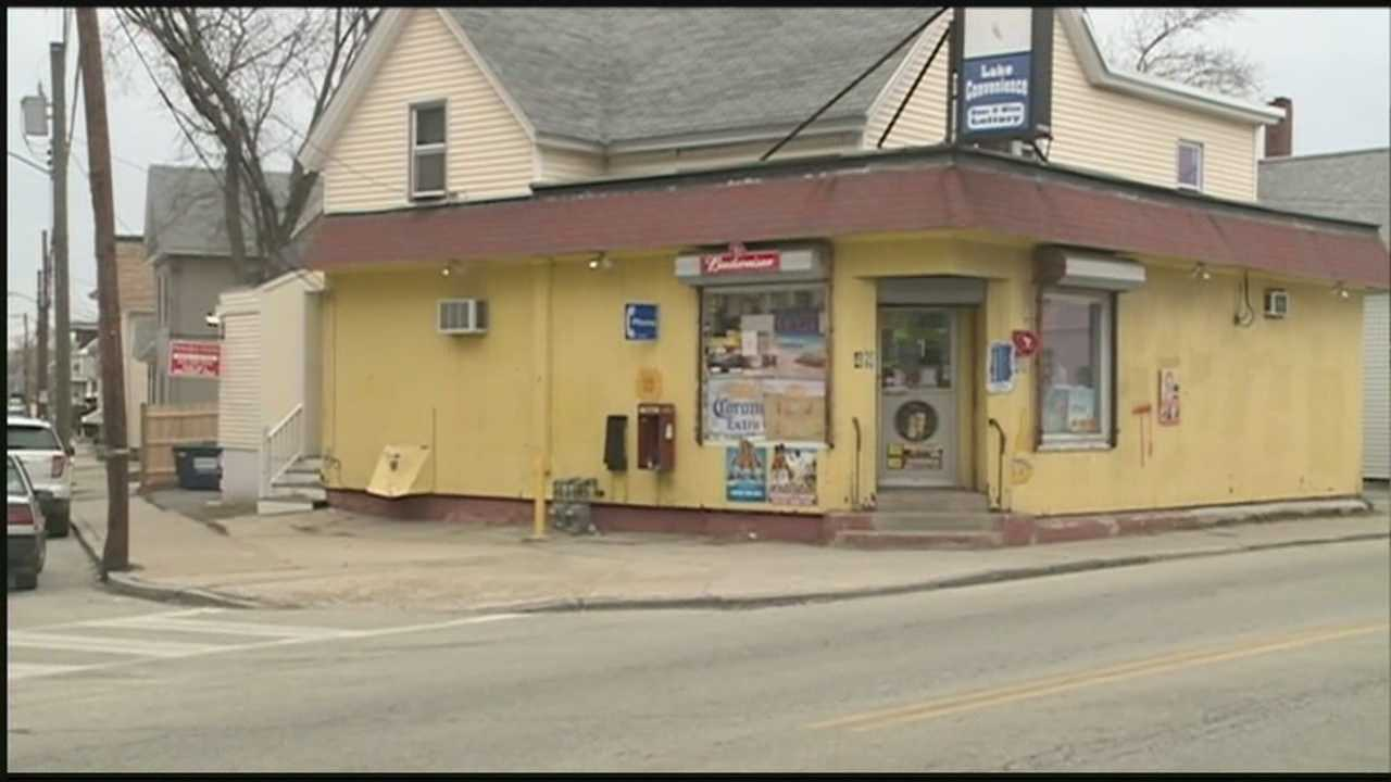 Store owner chases away robber with pipe