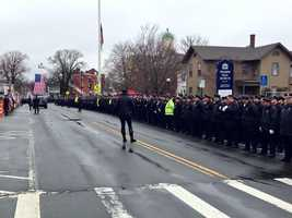Law Enforcement line the street in formation
