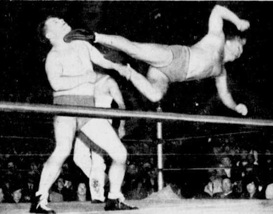 "John E. ""Dropkick"" Murphy was a Massachusetts professional wrestler. Murphy, who died in 1977, is seen here in action."