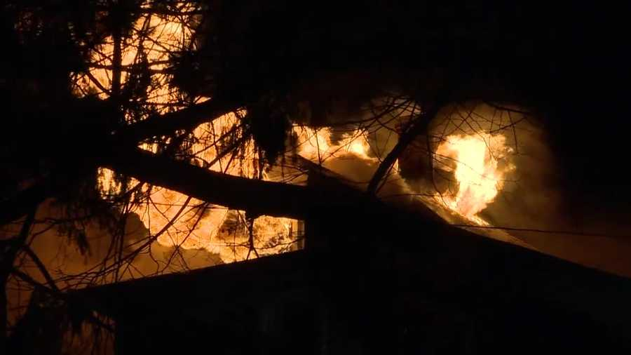 Firefighters were pushed back by explosion as they battled flames at a Lawrence home late Wednesday night.