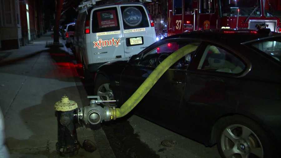 Firefighters smashed through the windows of an illegally-parked vehicle to access a fire hydrant after a large fire in East Boston Wednesday night.