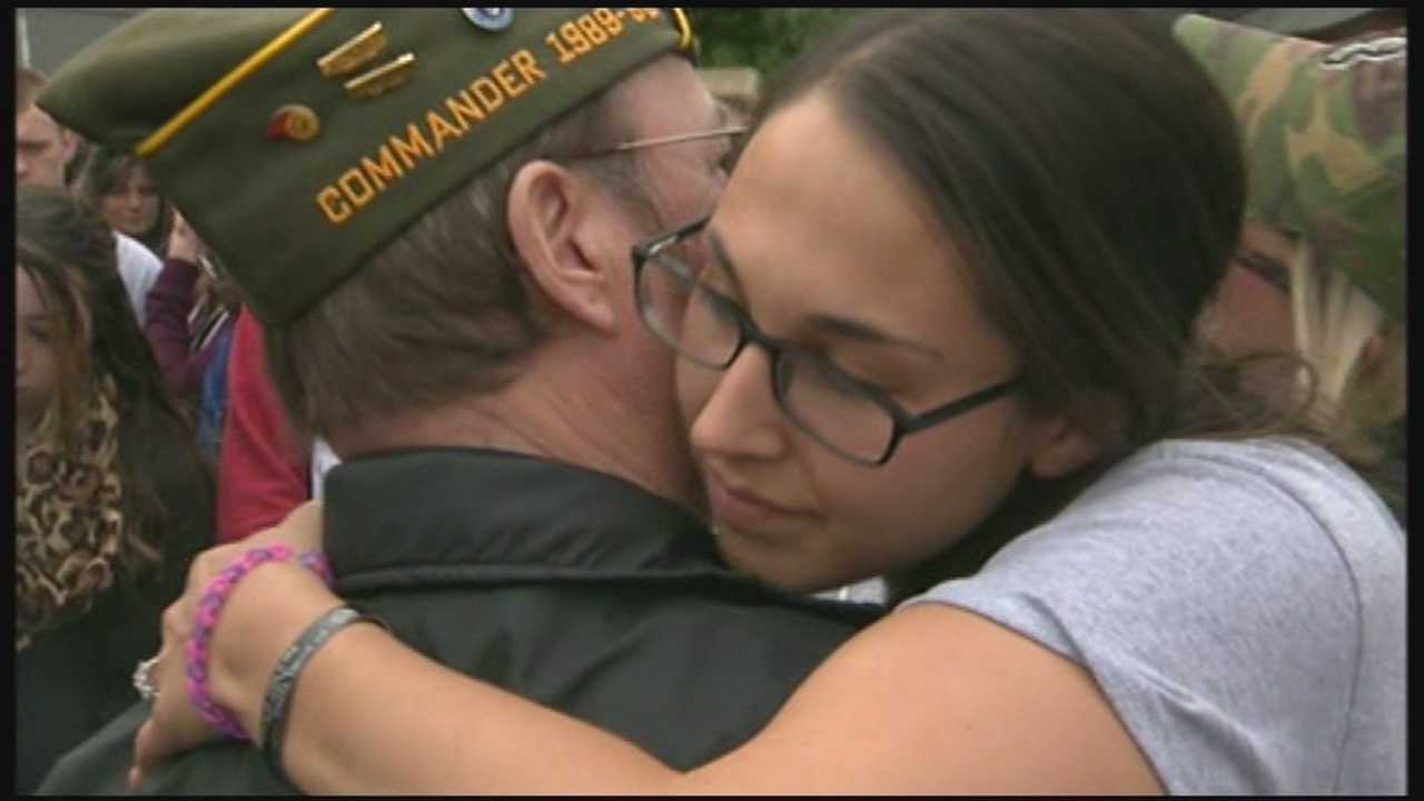Patriotic welcome for woman who lost fiancee at Ft. Hood