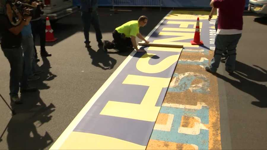 Part of Boylston Street was closed Monday morning as workers installed the adhesive sticker across the road.