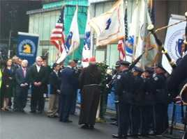 Cardinal O'Malley and survivors of the Boston Marathon blast, including the Richard family, gather to lay a wreath.