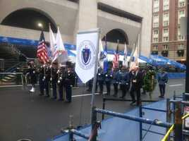 The Honor Guard arrives at the Boston Marathon finish line early Tuesday morning to honor those affected by the blast one year ago.