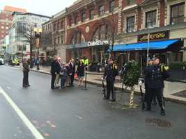 The Richard family looks on as the honor guard stands by the wreaths.