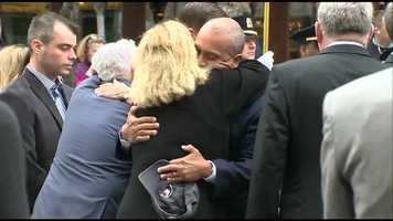 Gov. Deval Patrick with the victims' families.