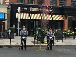 Guarding the wreath at the site of the second explosion.