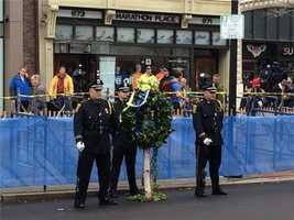 Standing guard by the wreath at the site of the first bomb.
