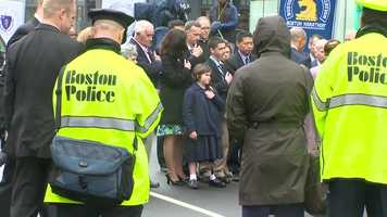 Jane Richard stands with her family at one of the bomb sites.