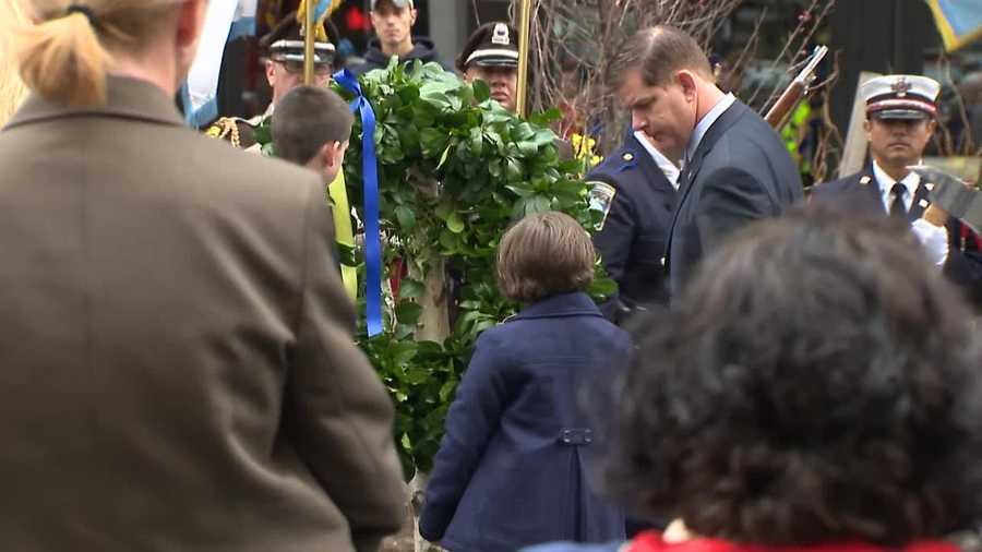 Mayor Marty Walsh looks down at Jane Richard.