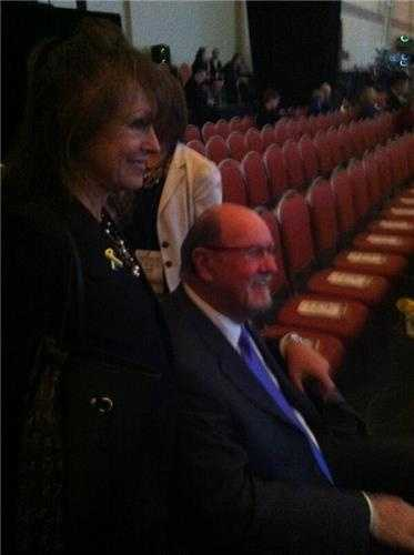 Survivor John Odom and his wife, Karen, arrive at the Hynes for the tribute.