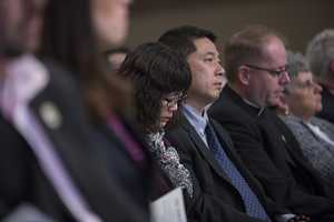 The parents of Boston University student Lu Lingzi who was killed in the bombing.