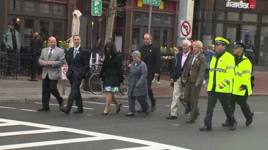 The Richard family walks down Boylston Street.